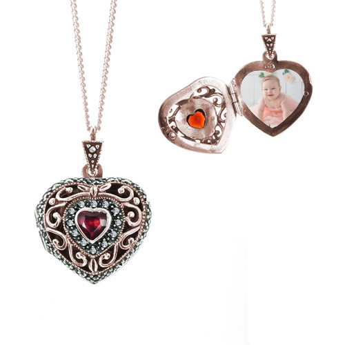 image of two vintage heart style locket in rose gold with a garnet gem and one photo fitted