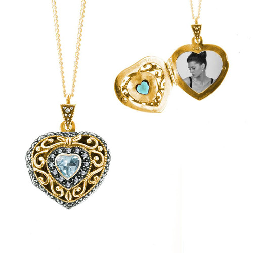 gold vintage style heart shaped locket with blue topaz gem and one photo