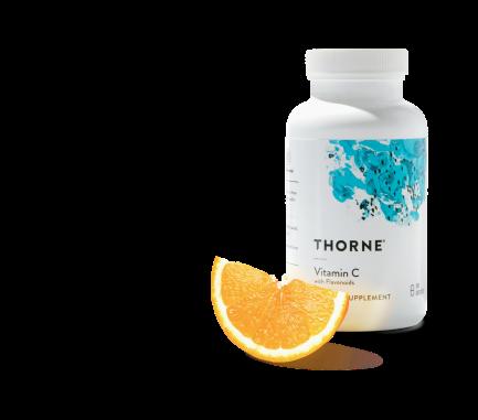 immune support Thorne bottle with orange next to bottle