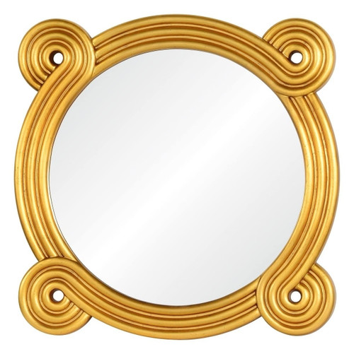 Round mirror finished in distressed gold by Bunny Williams