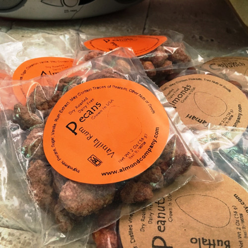 Vanilla Rum Pecans - Fresh, whole pecans dry roasted ,exotic blend Cinnamon Roasted Almonds vanilla Buffalo Flavored Peanuts - Sweet, savory, and spicy! These Buffalo Peanuts are one of our signature products and one of our most popular items! Coconut Cashew Crunch - These cashews are IMPOSSIBLE to put down, and at parties, they go QUICK! Tamari Flavored Almonds - a savory coat of Tamari sauce to create a naturally low-carb, healthy snack, these almonds are PERFECT for when you crave a (lightly) salty, crunchy snack, but don't want to deal with all of the carbs, sugar, and fat that usually accompany these type of snacks.