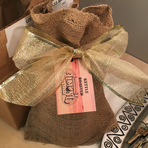 One lb. of our of our Buffalo Peanuts in a real burlap bag, tied with a lace bow.