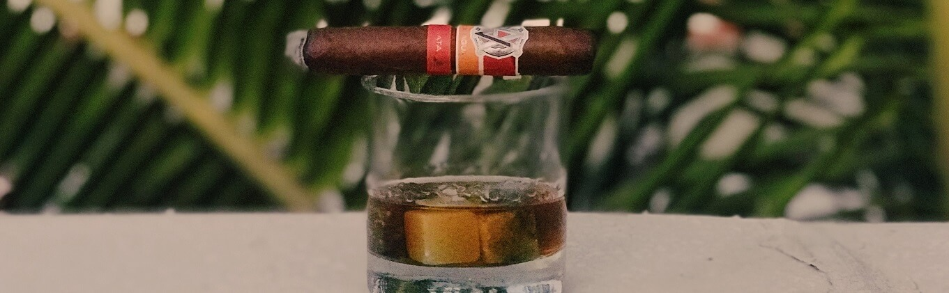 Bourbon Glass and Cigar resting on top