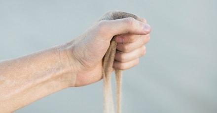 Sand running through fist