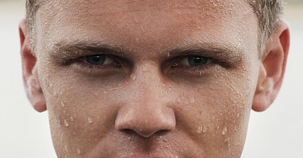 man with wet face