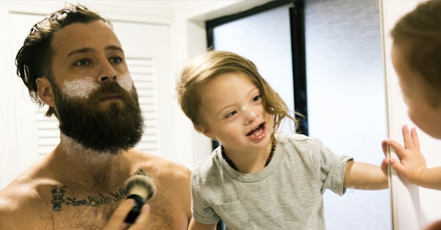 Father shaving with young son