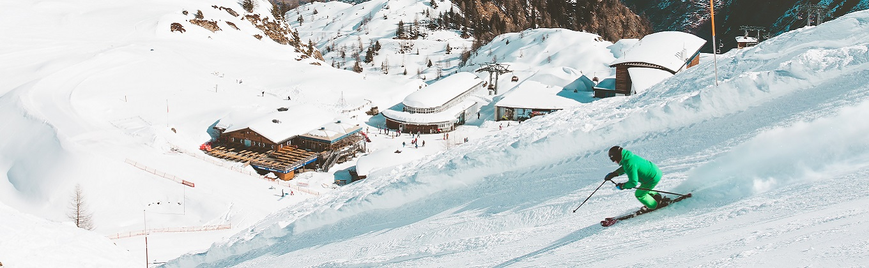 Skiing down mountain slope