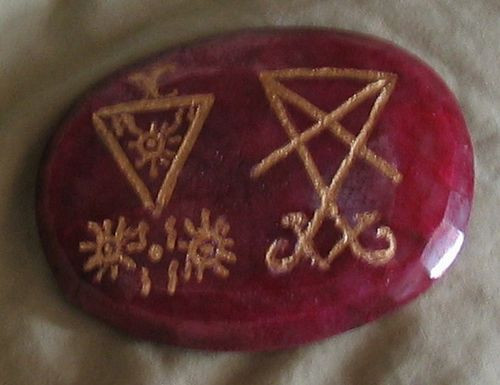 """1/2"""" or larger ruby cabochon engraved a listed entity seal"""