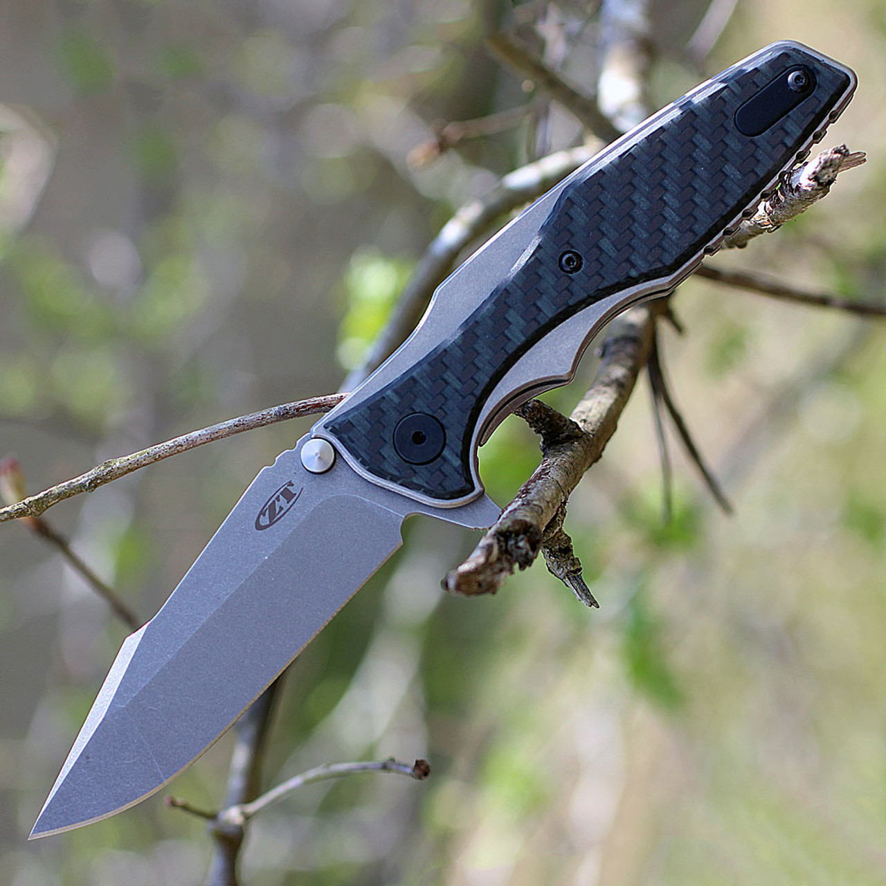 "Zero Tolerance 0393GLCF, 3.5"" CPM 20CV Plain Blade, Titanium/Glow in the Dark Carbon Fiber Handle"
