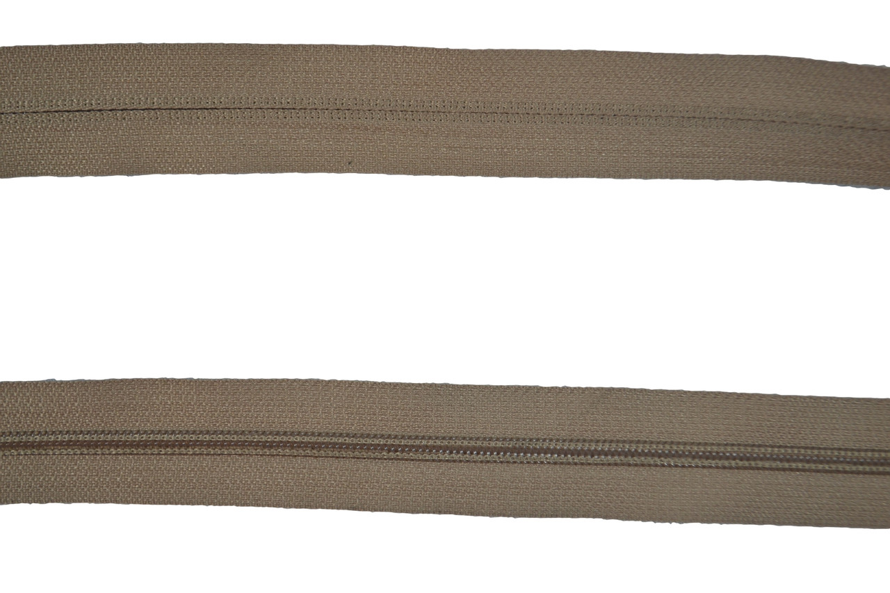 Dunlap Beige Sew on Style Plastic Tooth Zipper Size #4 for Upholstery Cushions. This is High Quality Sew On Style Zipper. This is a 5 Yard Section of Zipper. This Zipper is 1 Inch Wide. The Zipper Teeth are a Hardened Plastic. The Fabric of Zipper is Nylon. This is a Universal Zipper That can Be used for Many Applications Including  pants, skirts, fine garments, cushions, clutch handbags and More. Contact Customer Service For additional Information and Bulk Pricing