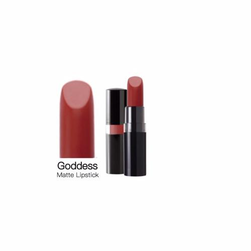 A luxurious, burnt red-orange, matte lipstick in a sleek black peekaboo case.