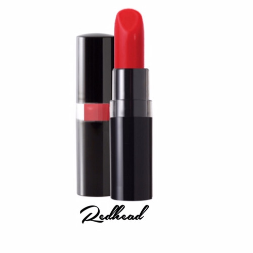 A 1950's Lucille Ball style fiery red orange luxe lipstick in a black peekaboo case