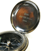 "open compass with the phrase ""seek and you shall find"" engraved"