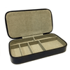 open brown leather jewelry box with cream colored inside showing the different compartments