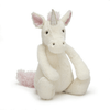 cream colored unicorn with baby pink ears, man and tail