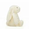side profile cream colored stuffed bunny