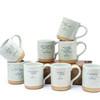 8 mugs sitting on a brick mold
