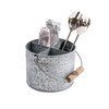 galvanized metal bucket with dividers and wood handle holding utensils