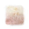 a square tibetan fur throw pillow with ivory fur on top that fades to a blush pink