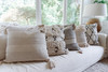 Cream Pillow with Grey Stitching and Tassels