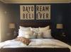 daydream believer art print above bed