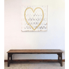 Heart of Gold art print hanging above a bench