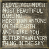 """This simple art print features a dark background and light font that says, """"I love you much most beautiful darling. More than anyone on the earth and I like you better than everything in the sky."""""""