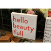 """Simple art print with white background the phrase """"Hello Beauty Full"""" in bright red font."""