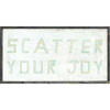 "This simple art print features a white background with the phrase ""Scatter your joy"" printed in a fun, multi-colored font."