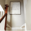 Frederick Buechner art print - white with grey wood frame  hung in stairwell