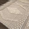 bath mat with diamond shaped design and fringe