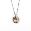sterling silver necklace with a round pendant and white topaz stone