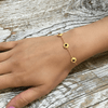 gold bracelet with black onyx charms