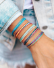 rainbow assortment of thread pull bracelets