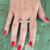 choose love bar ring on hand