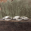 choose love, daydream believer, courage dear heart, expect miracles, and breathing dreams like air silver ring