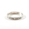 """silver ring with """"breathing dreams like air"""" engraved"""