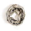 cream infinity scarf with black design and pompom trim
