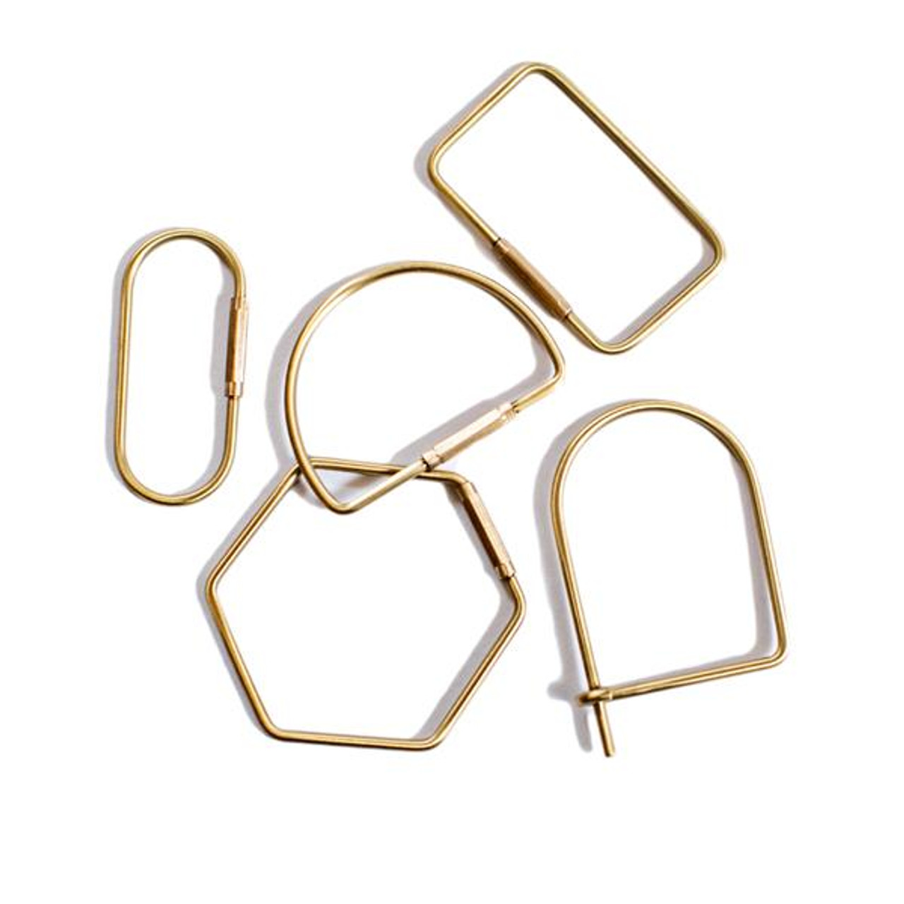 one of each shaped brass keychains