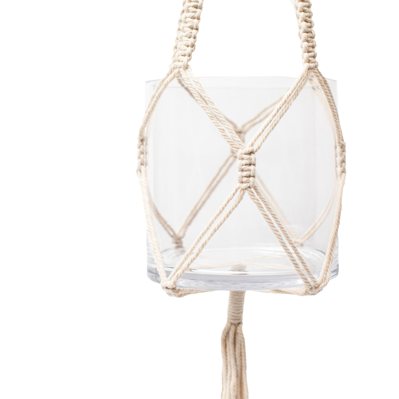 close up picture of the macrame detailing that holds the glass vase