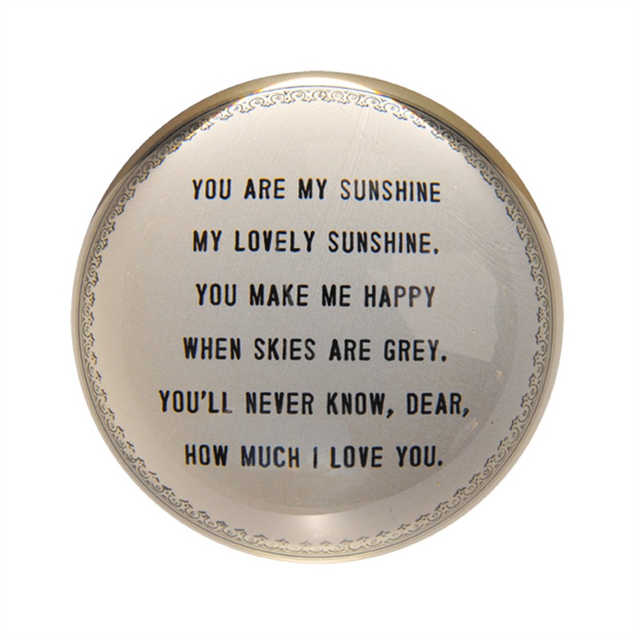 round paperweights with a dark cream backing and black writing