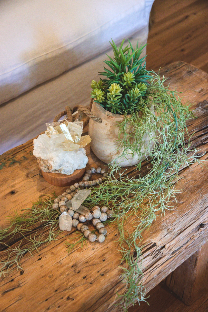 wooden hanging planter on coffee table