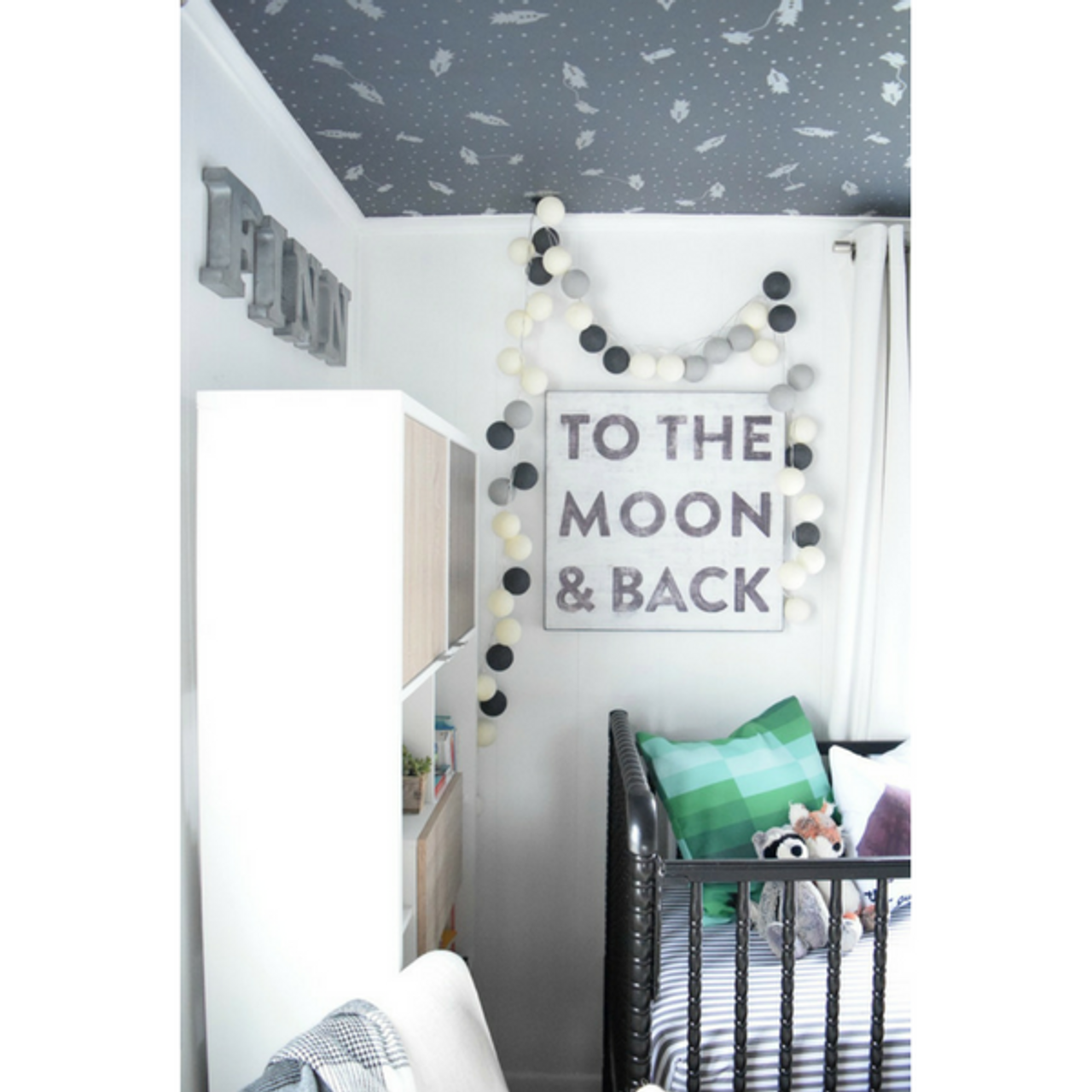 """This simple art print features a white background with """"To The Moon & Back"""" printed in black font."""