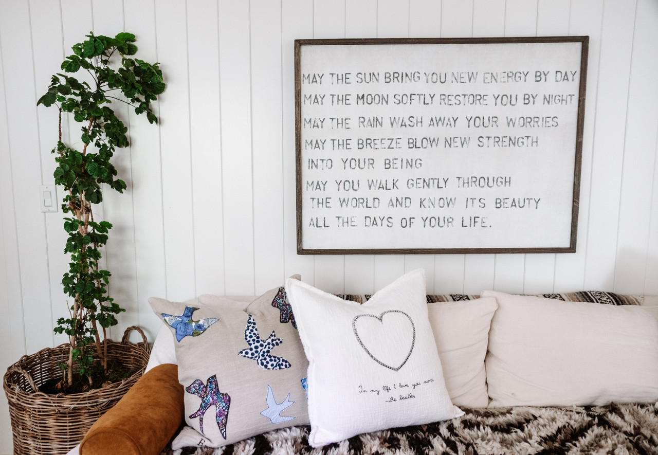 apache blessing art print with greywood frame hanging above a couch
