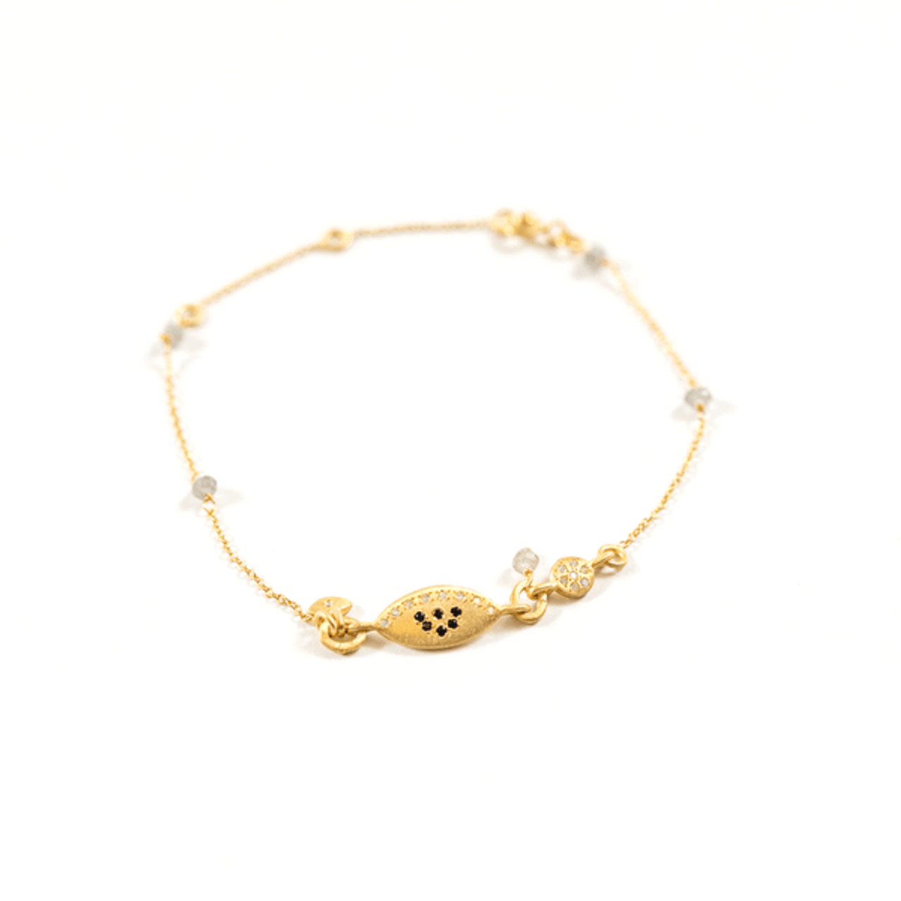 gold bracelet with white and black zircon
