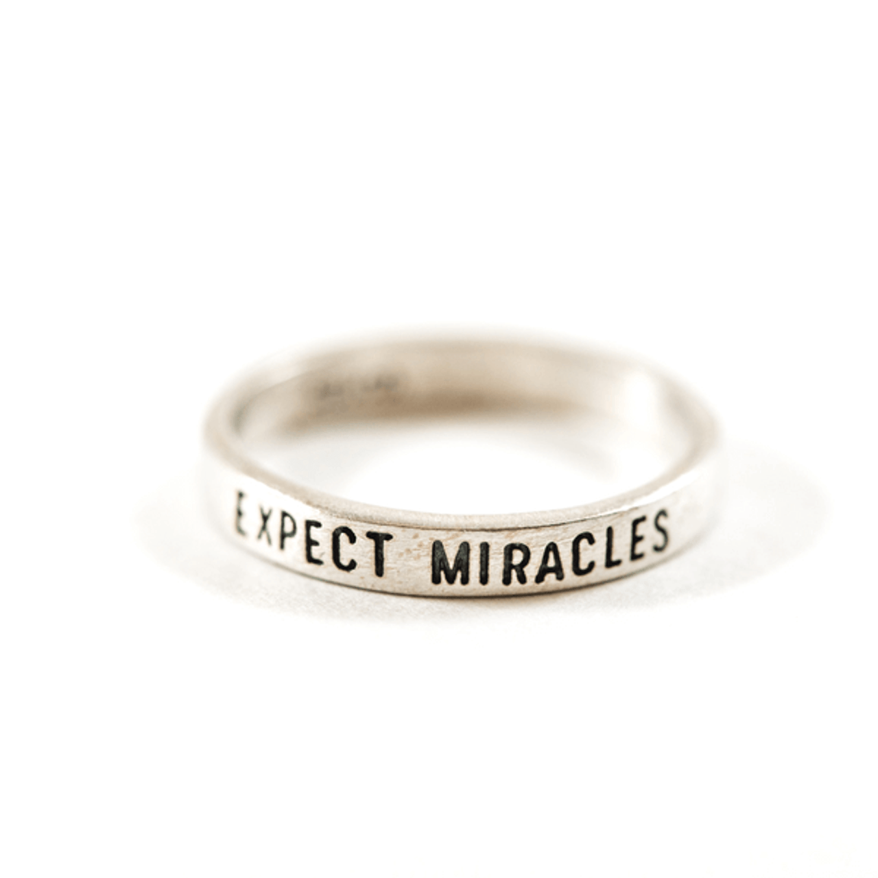 """sterling silver ring with """"expect miracles"""" engraved"""
