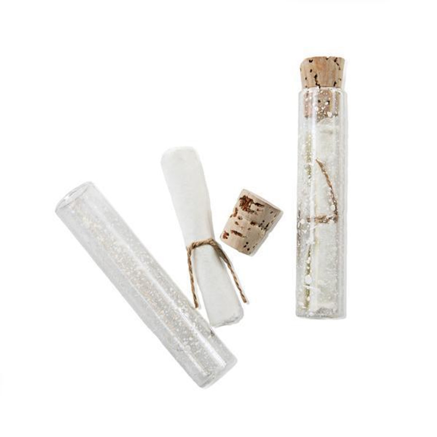 two bubble glass vials with cork top and white parchment paper