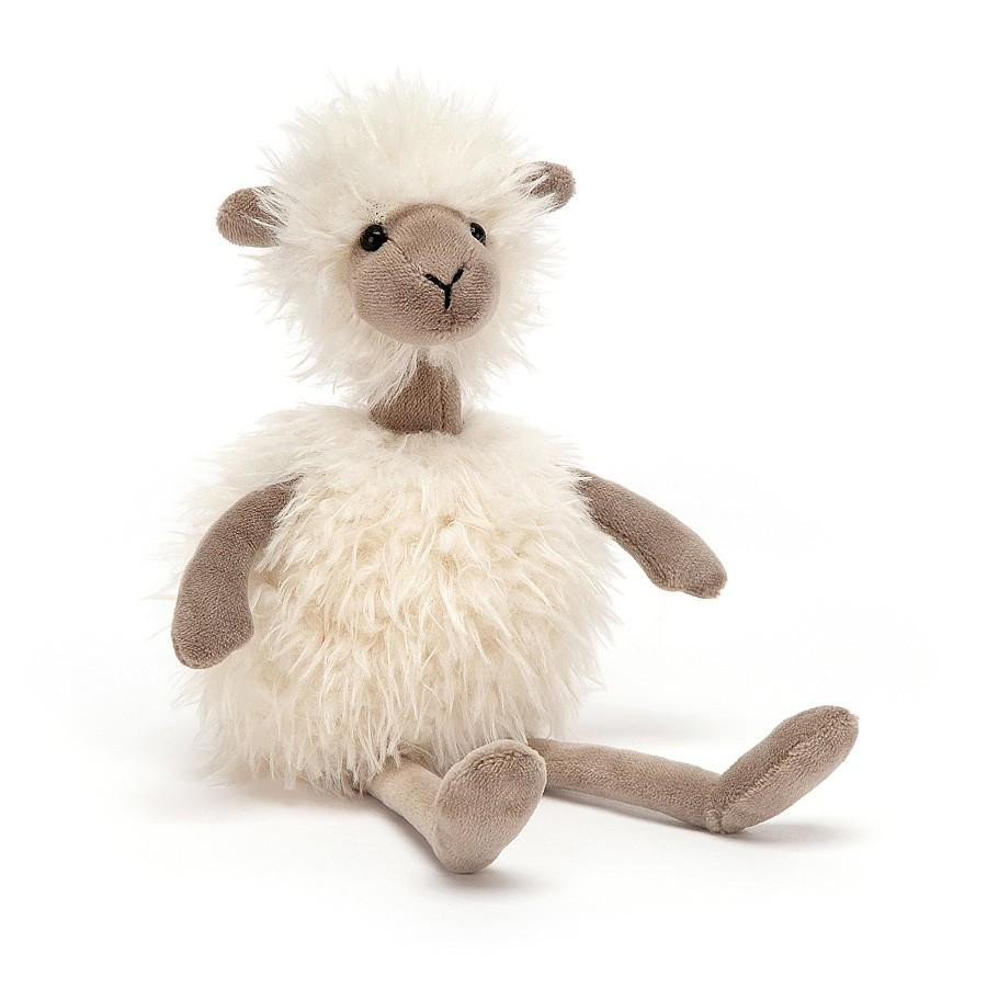 cream fuzzy sheep sitting down with light brown arms and legs