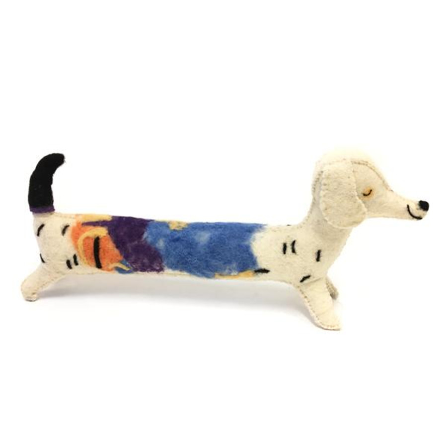 long skinny white dog toy with a black tail and a multicolored detail along the back