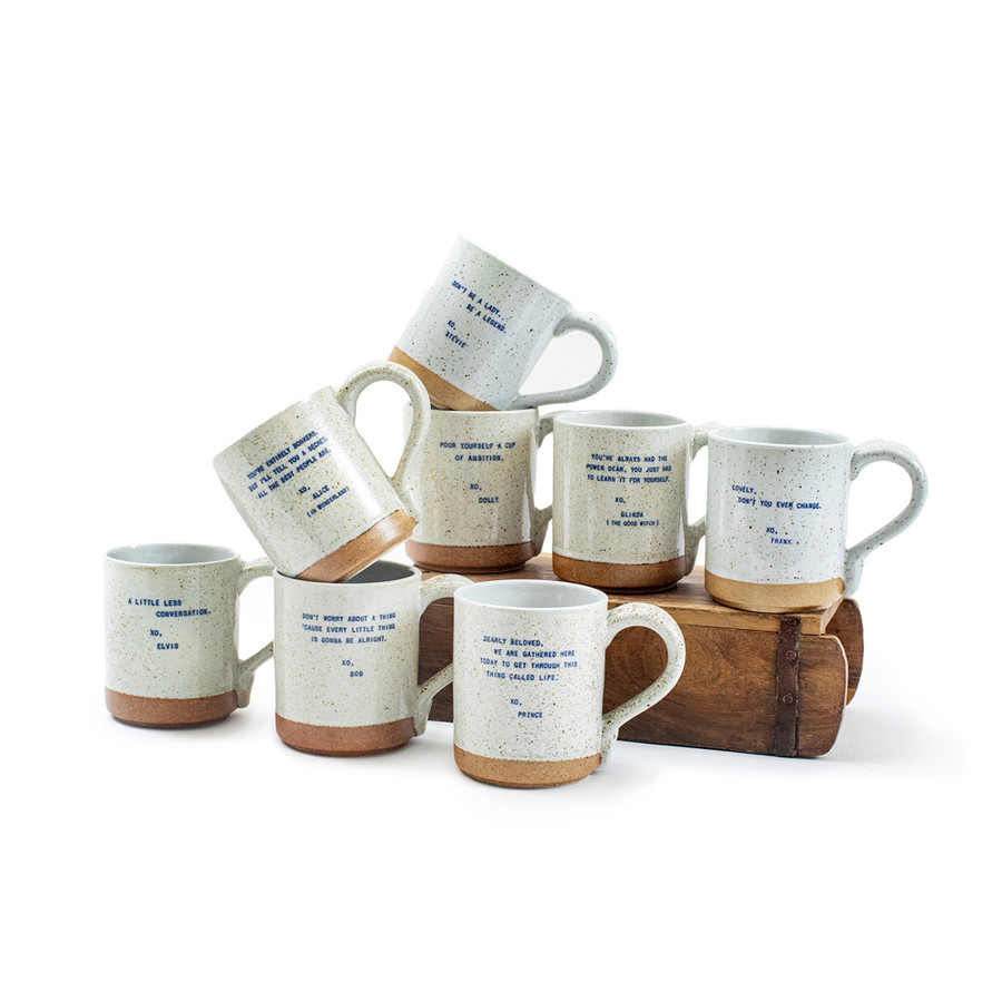 8 mugs sitting on a brick mold